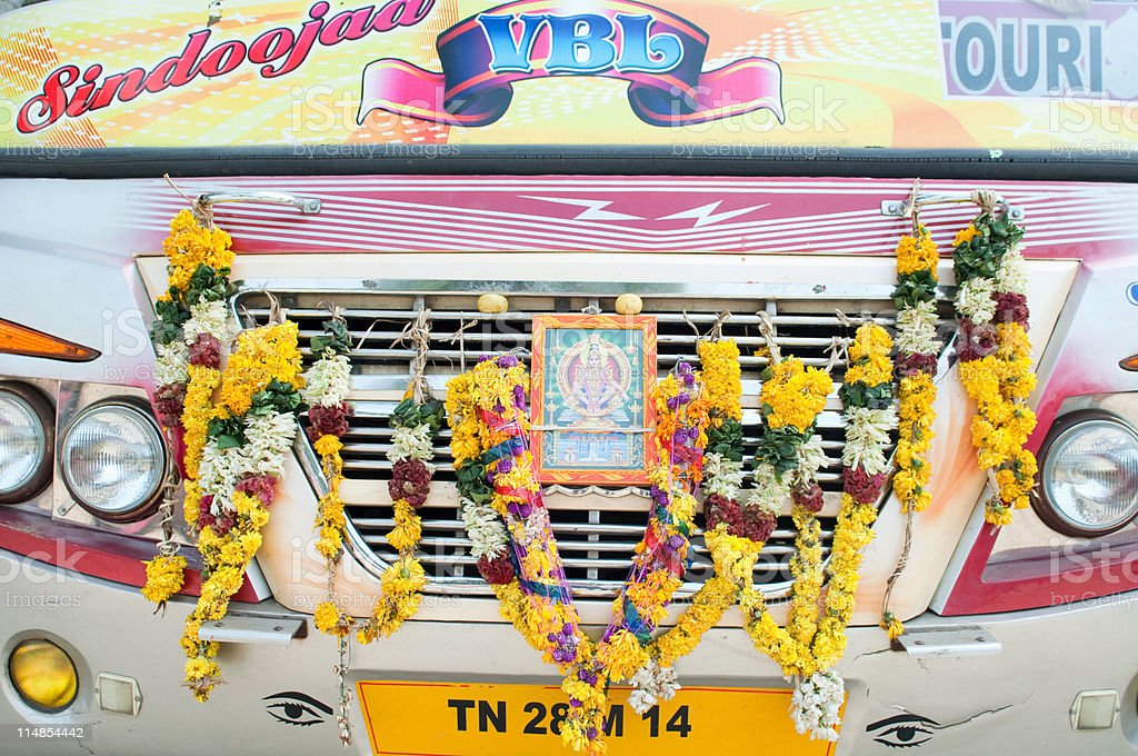 Hindu garland on the front of bus used on a pilgrimage, Tanjore, Tamil Nadu stock photo