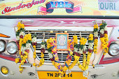 Hindu garland on the front of bus used on a pilgrimage, Tanjore, Tamil Nadu