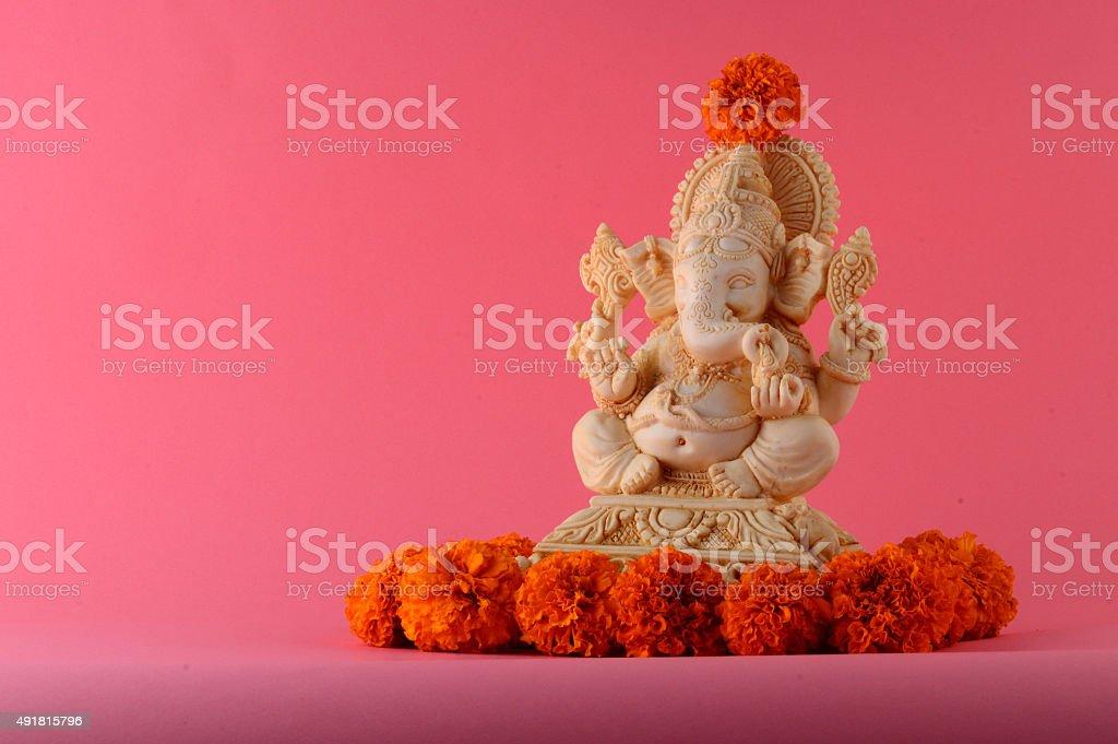 Hindu God Ganesha. Ganesha Idol on pink Background. stock photo