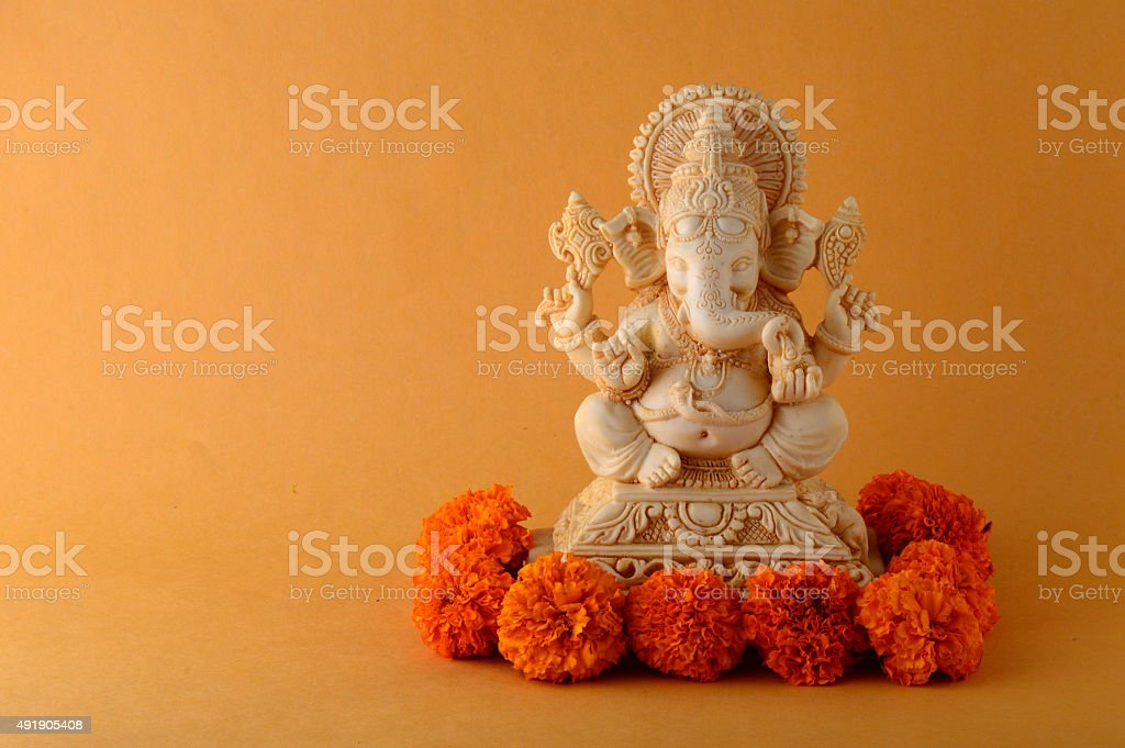 Hindu God Ganesha. Ganesha Idol on Yellow Background. stock photo