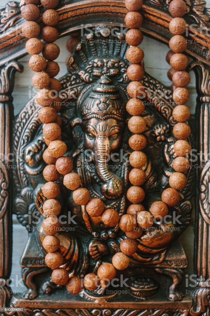 Hindu God - Ganesha with rudraksha rosary. stock photo