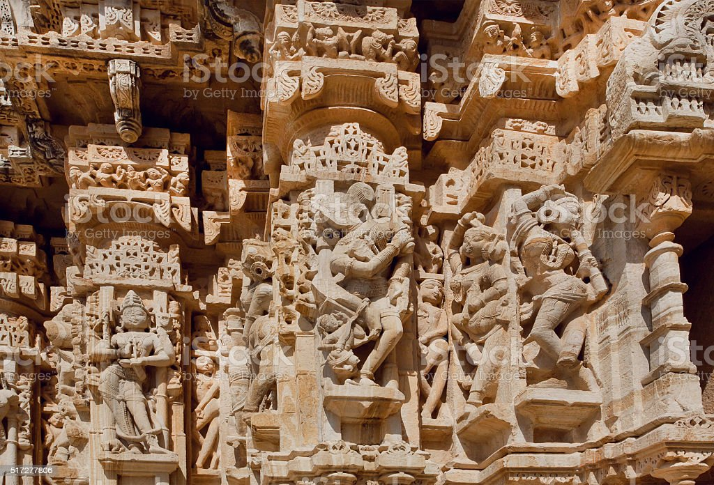Hindu gods on the carved stone wall stock photo