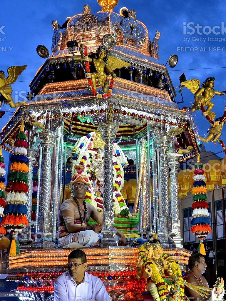 Hindu holy man on decorated palanquin Sri Mariamman Temple Singapore royalty-free stock photo