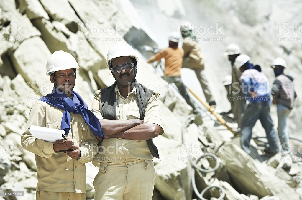 Hindu indian builders workers at construction site stock photo
