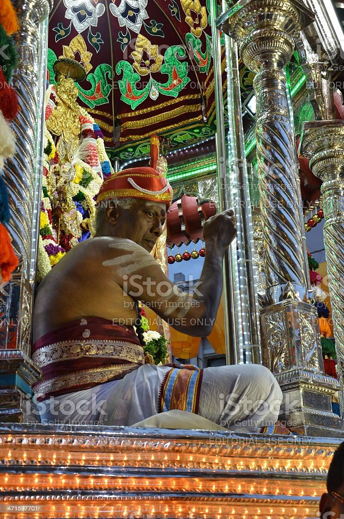 Hindu man in costume sits on vehicle for festival royalty-free stock photo