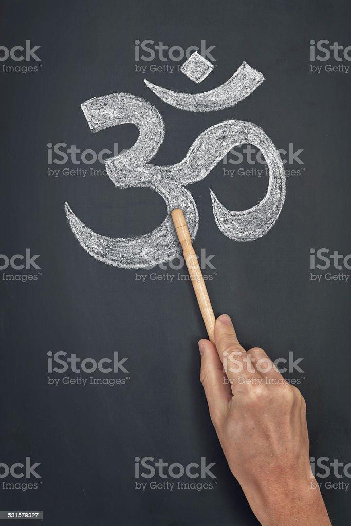 hindu om symbol symbol on blackboard stock photo