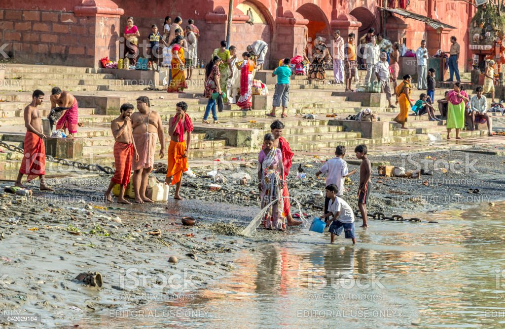 hindu people bath in the  holy river Ganges stock photo