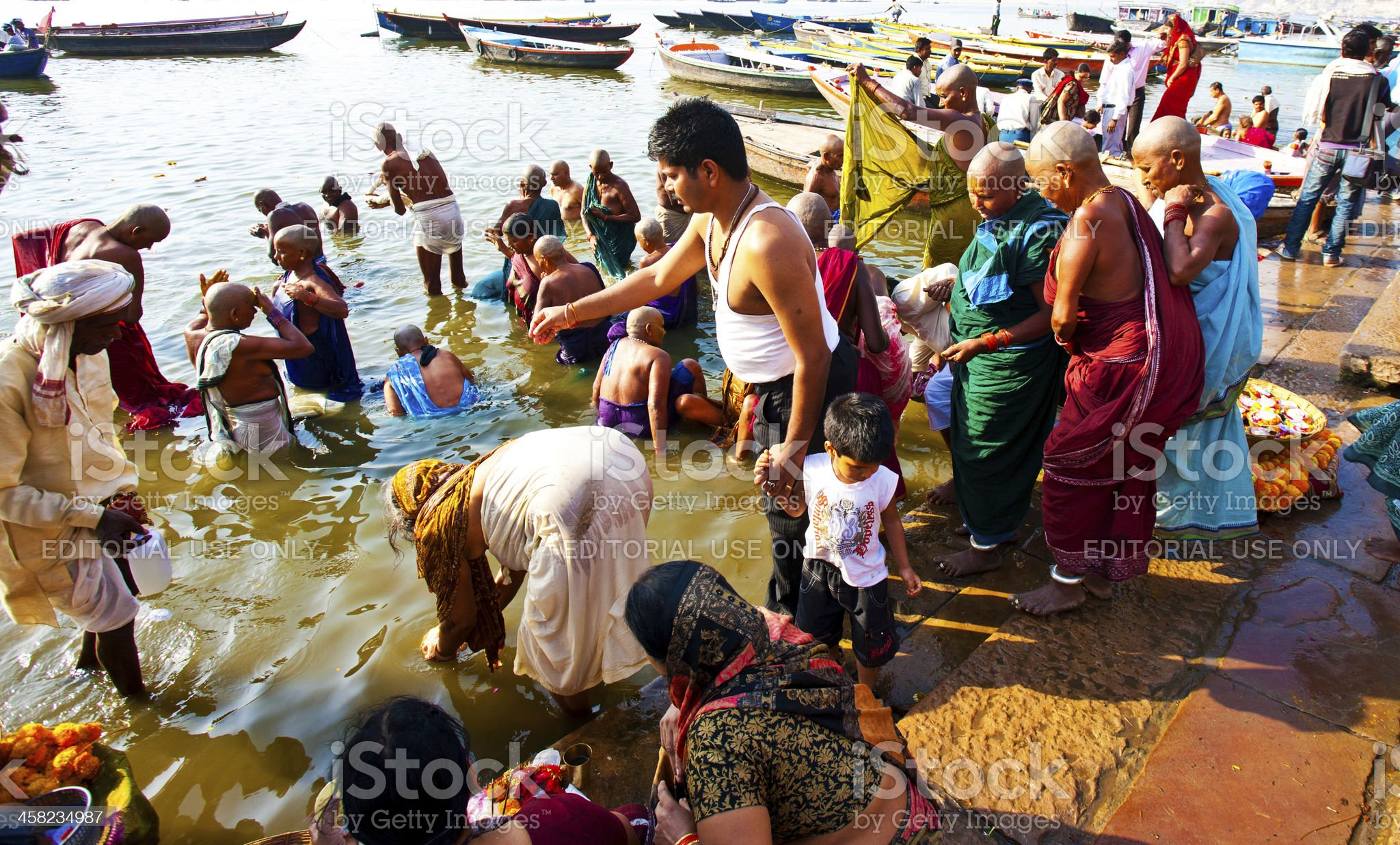 Hindu people taking morning bath in the Ganges river royalty-free stock photo