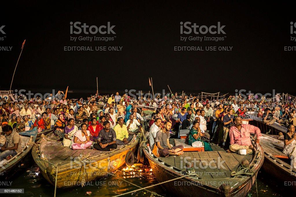 Hindu pilgrims in boats in Varanasi India stock photo