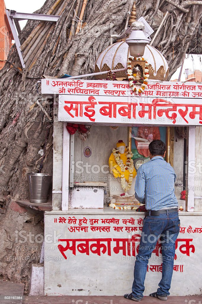 Hindu place of worship at the side of the road stock photo