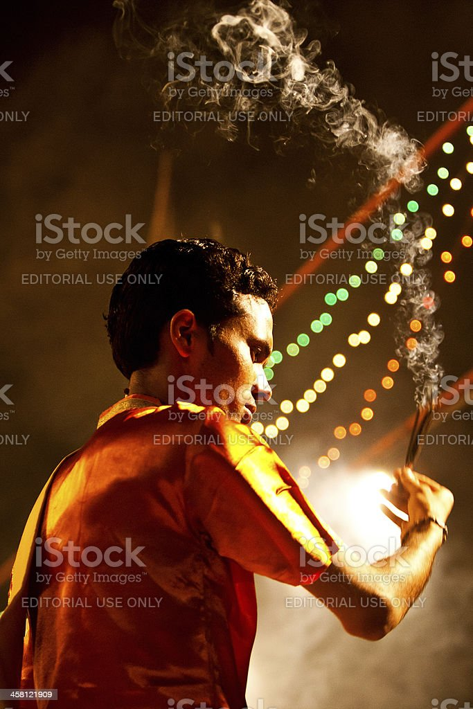 Hindu priest performing religious Ganga Aarti ritual (fire puja) royalty-free stock photo