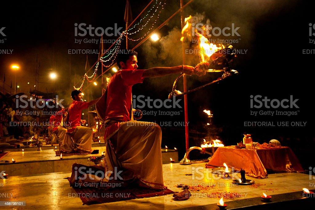 Hindu priest performing religious Ganga Aarti ritual (fire puja) stock photo