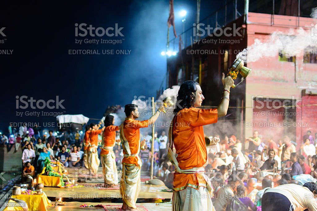 Hindu priest performs the Ganga Aarti in Varanasi. stock photo