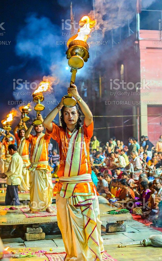 Hindu priests performs the Ganga Aarti ritual in Varanasi stock photo