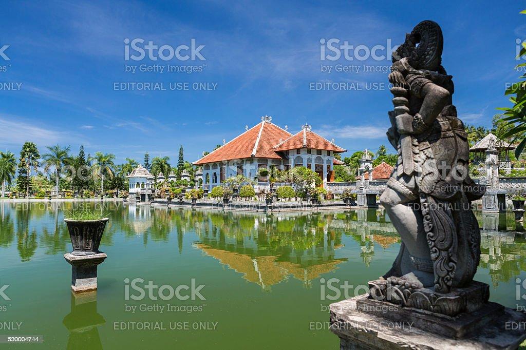 Hindu statue facing Taman Ujung water palace in Bali stock photo