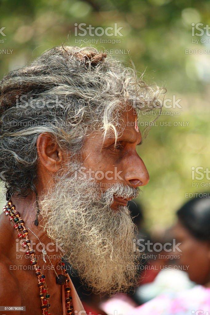 Hindu temple priest's side pose stock photo