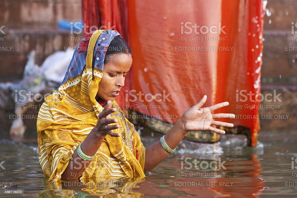 Hindu woman taking morning bath in the Ganges river royalty-free stock photo