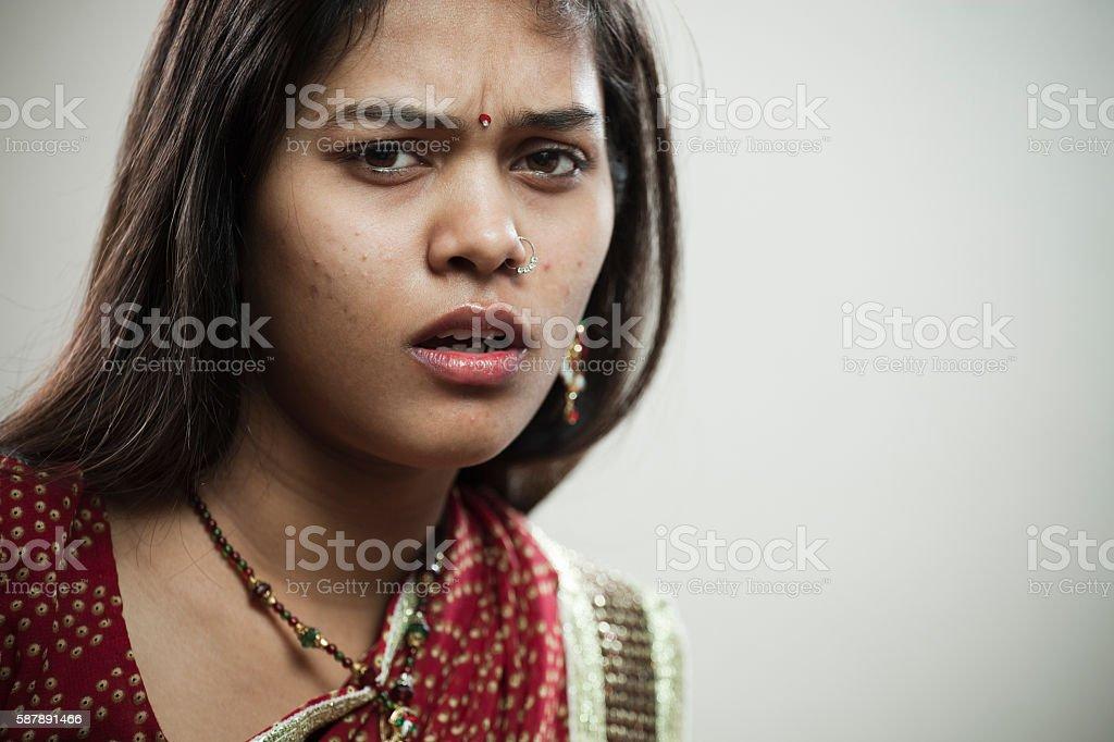 Hindu young woman frowning and looking at camera. stock photo