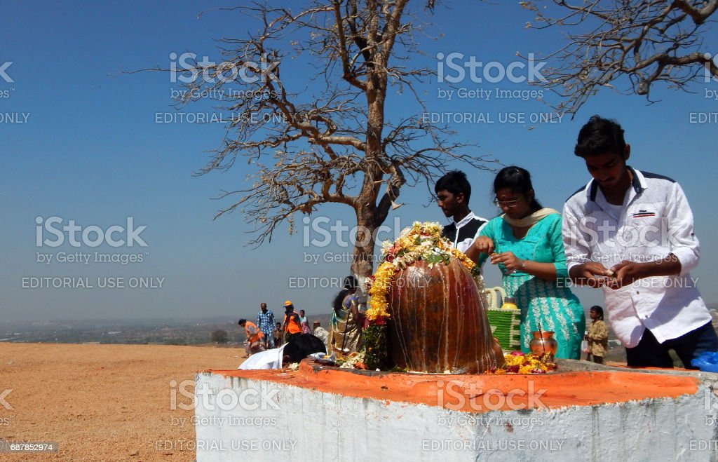 Hindus perform Puja to lord Shiva stone statue, near the temple, in Mahasihvaratri fesival stock photo