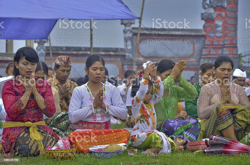 Hindus was praying to celebrate the feast of kuningan stock photo