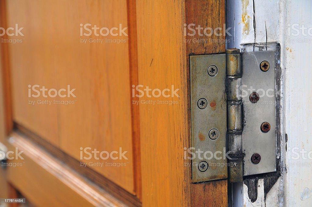 hinge on old wooden door royalty-free stock photo