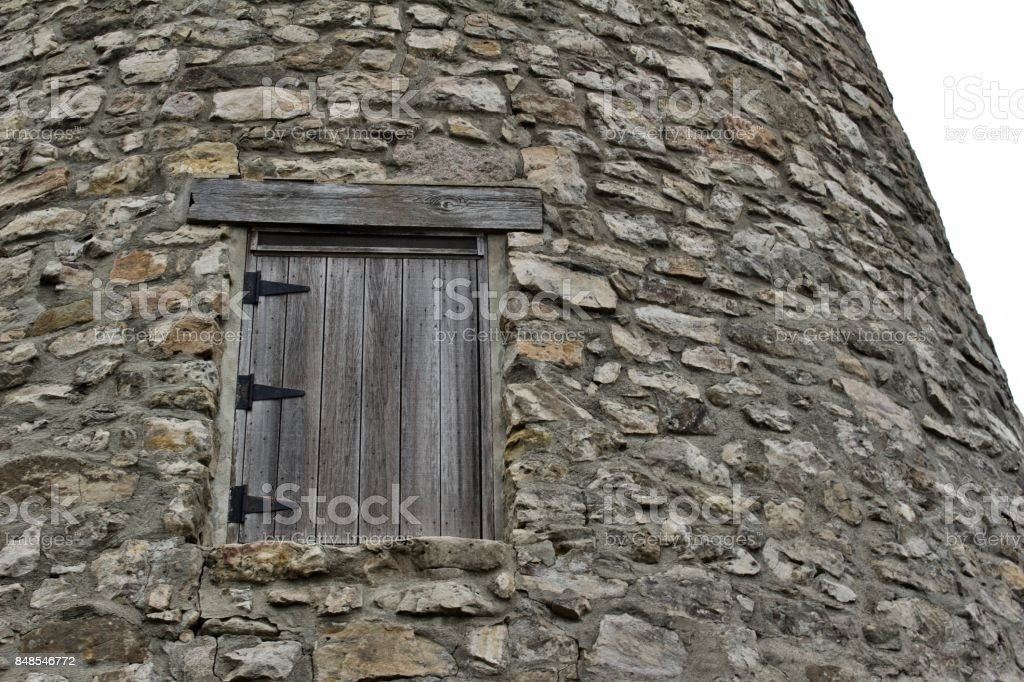 Hinged wooden window entrance to old gristmill building stock photo