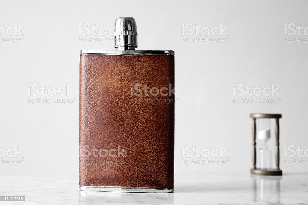 Hip flask and sandglass. royalty-free stock photo