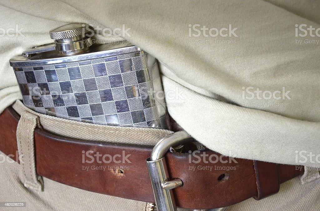 Hip flask under belt royalty-free stock photo