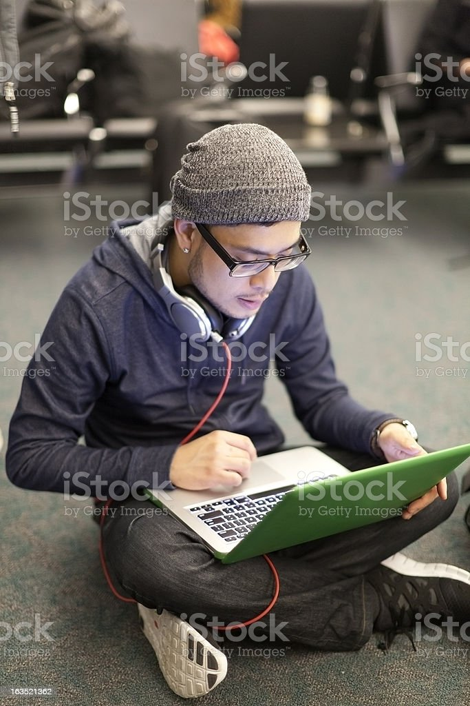 Hip Guy Using Laptop in Airport royalty-free stock photo