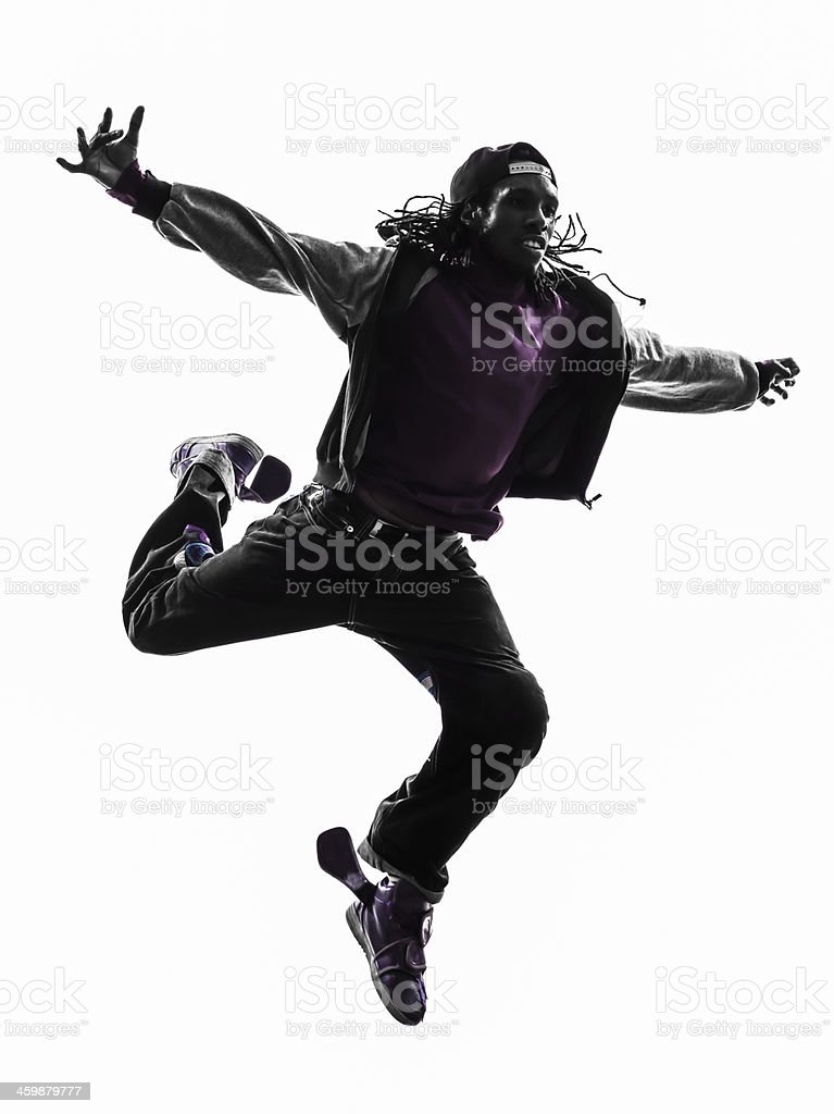 hip hop acrobatic break dancer breakdancing young man jumping silhouette stock photo