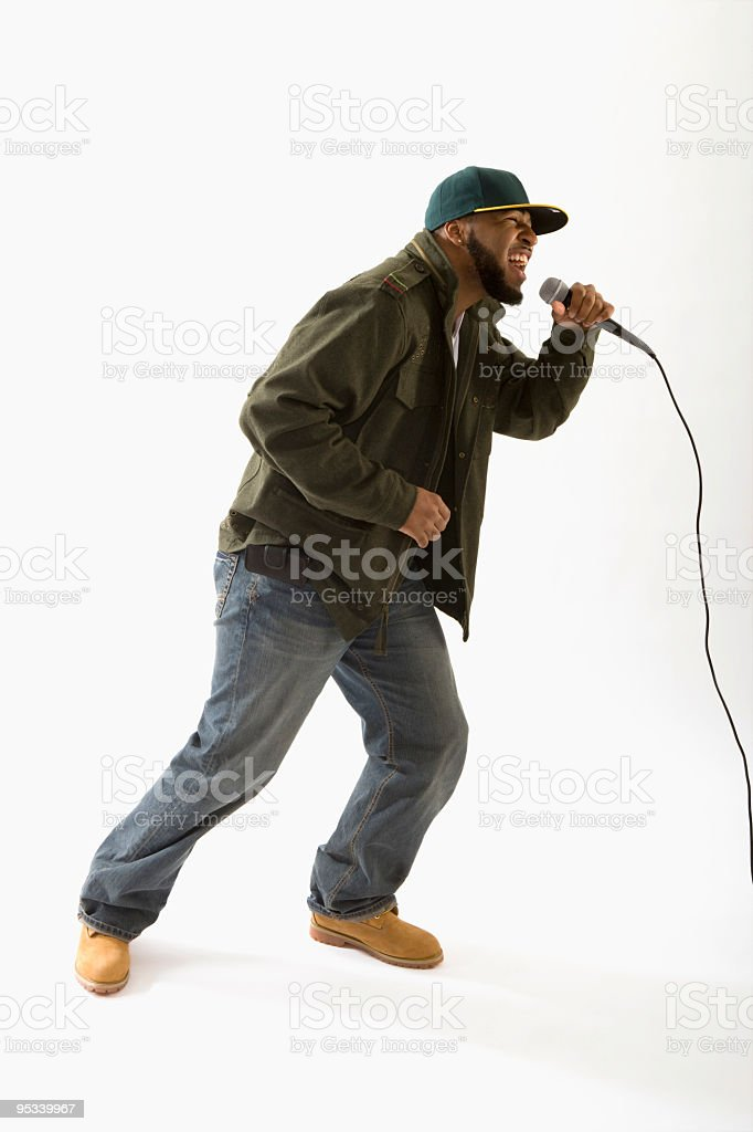 A hip hop artist singing into a microphone stock photo