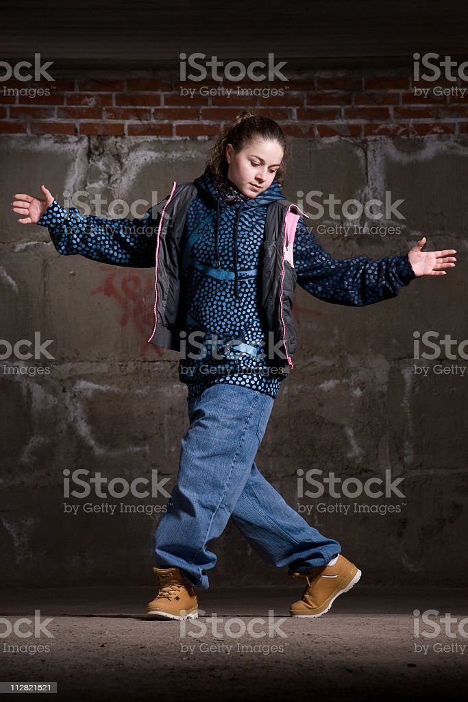 Hip hop dancer in modern style over brick wall royalty-free stock photo