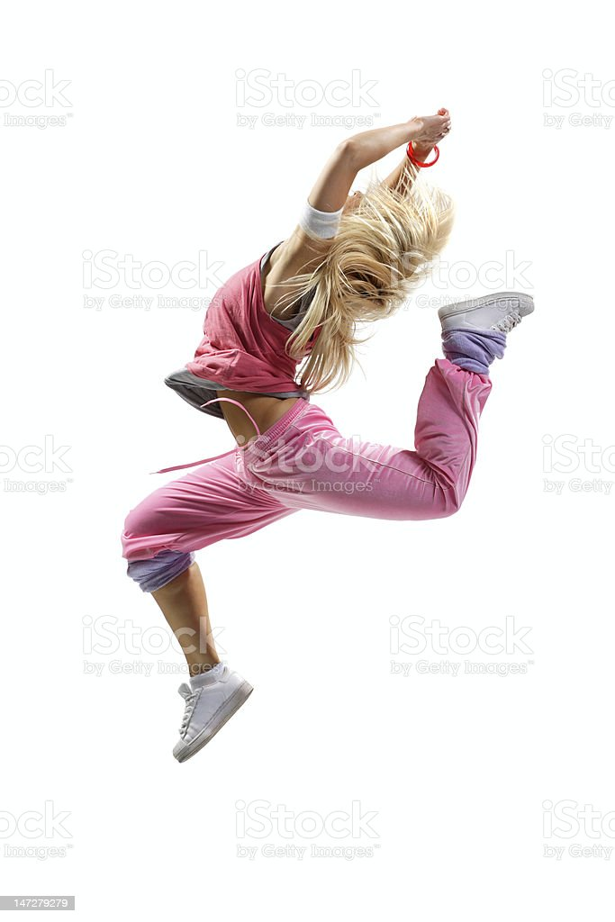 Hip hop dancer in pink outfit mid jump royalty-free stock photo
