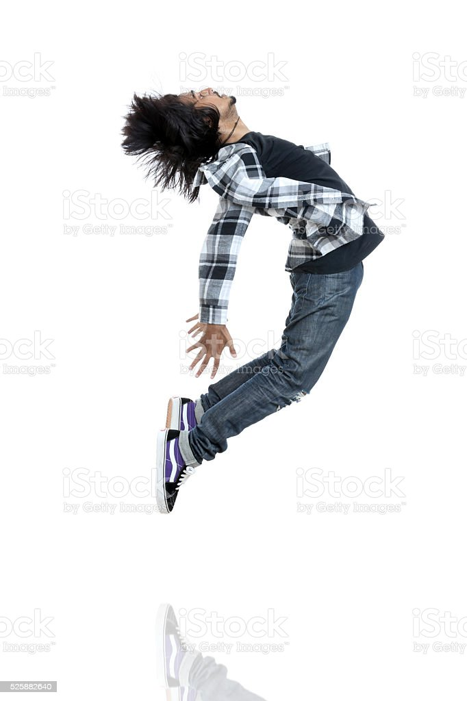 Hip hop dancer jumping stock photo