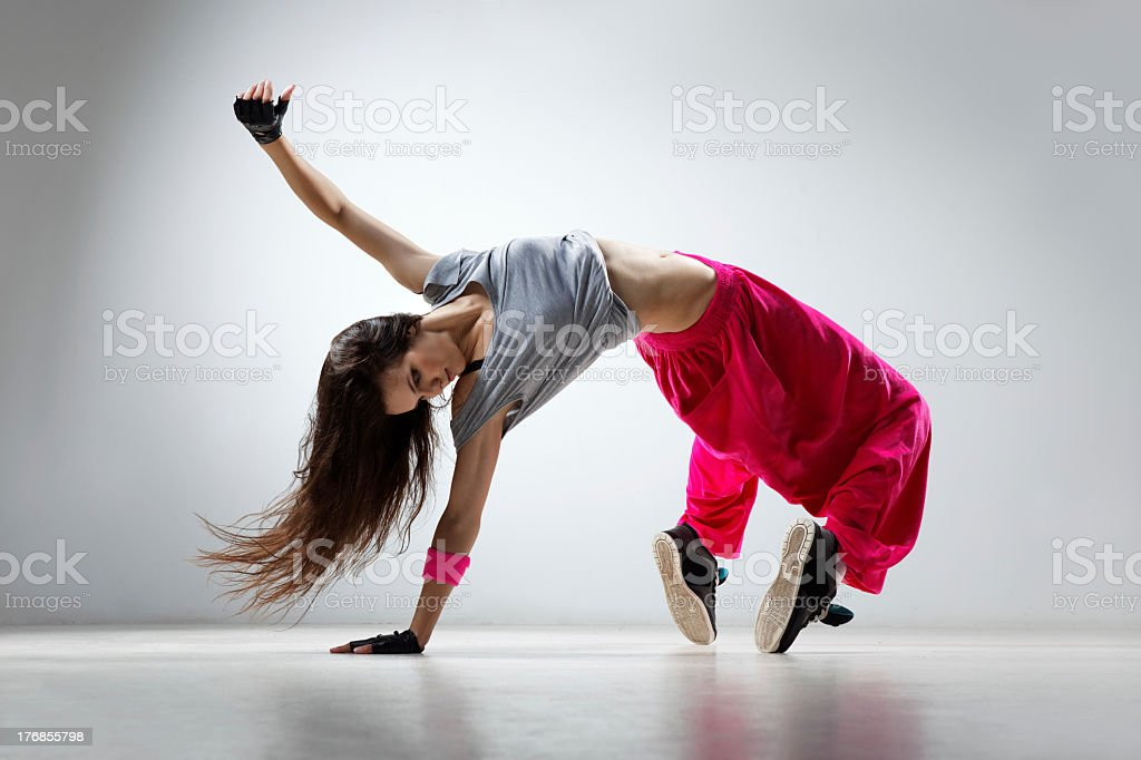 Hip hop female dancer executing a difficult move stock photo