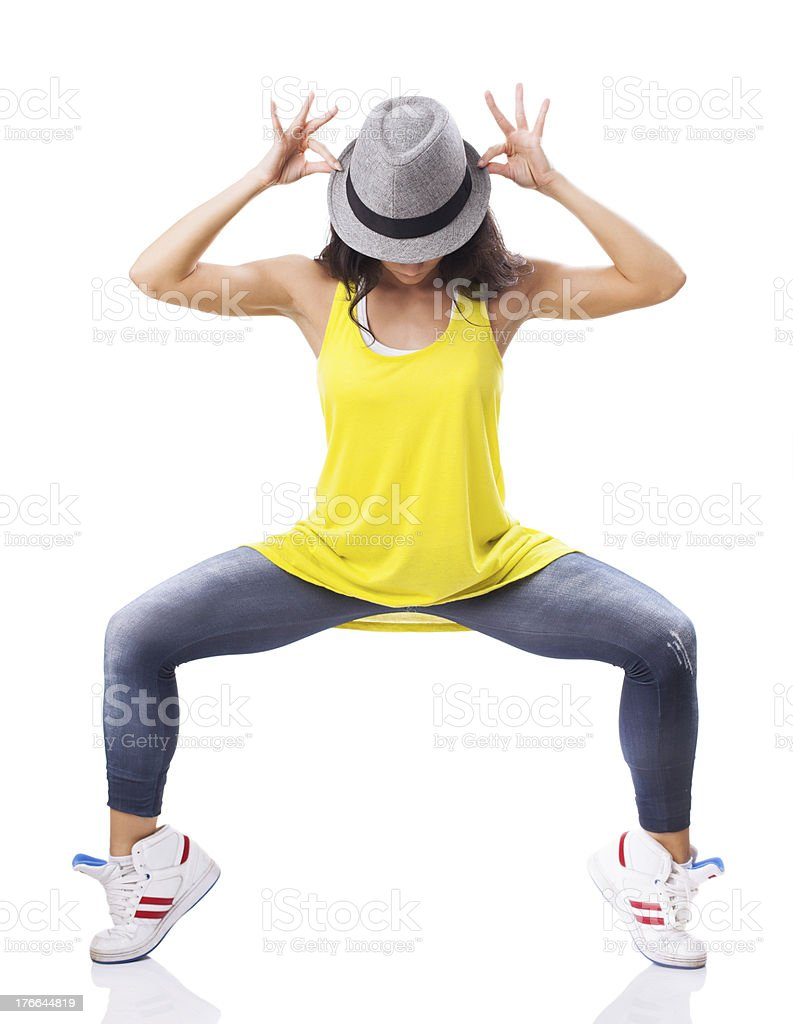 Hip hop style female dancer with hat posing royalty-free stock photo