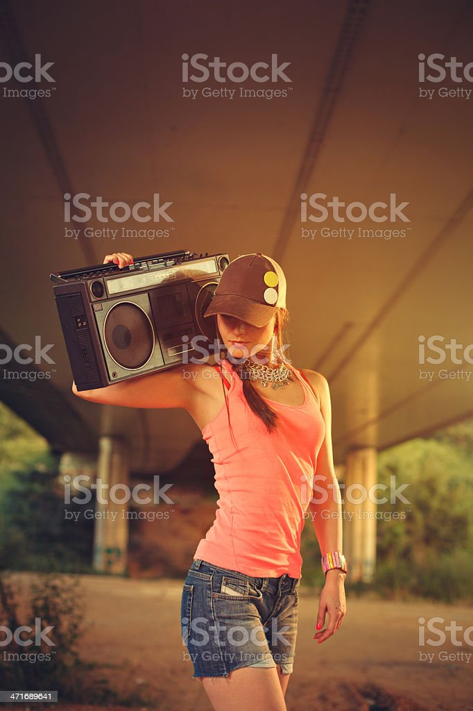 Hip hop women with a tape recorder royalty-free stock photo