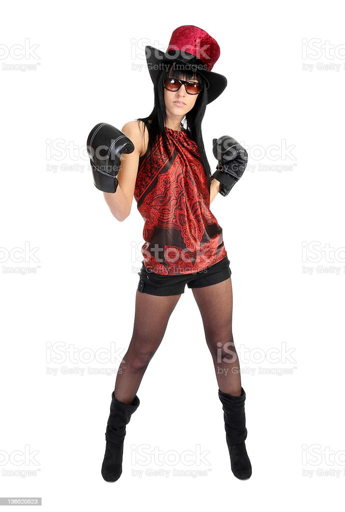 hip looking girl with velvet hat and boxing gloves stock photo