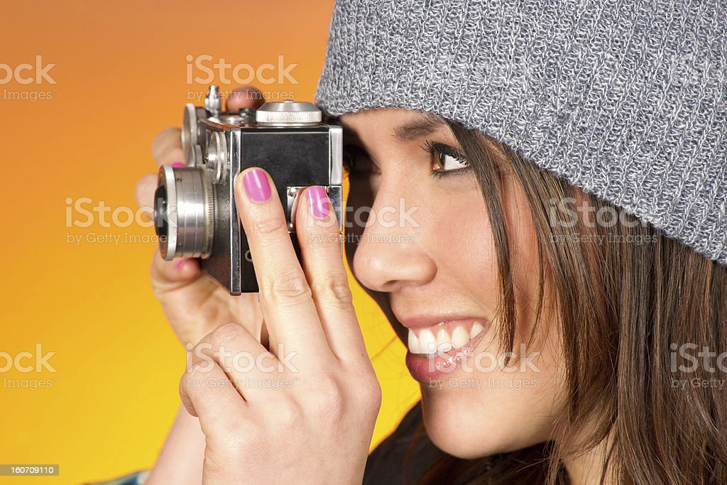 Hip Woman Snaps a Picture with Vintage Camera royalty-free stock photo