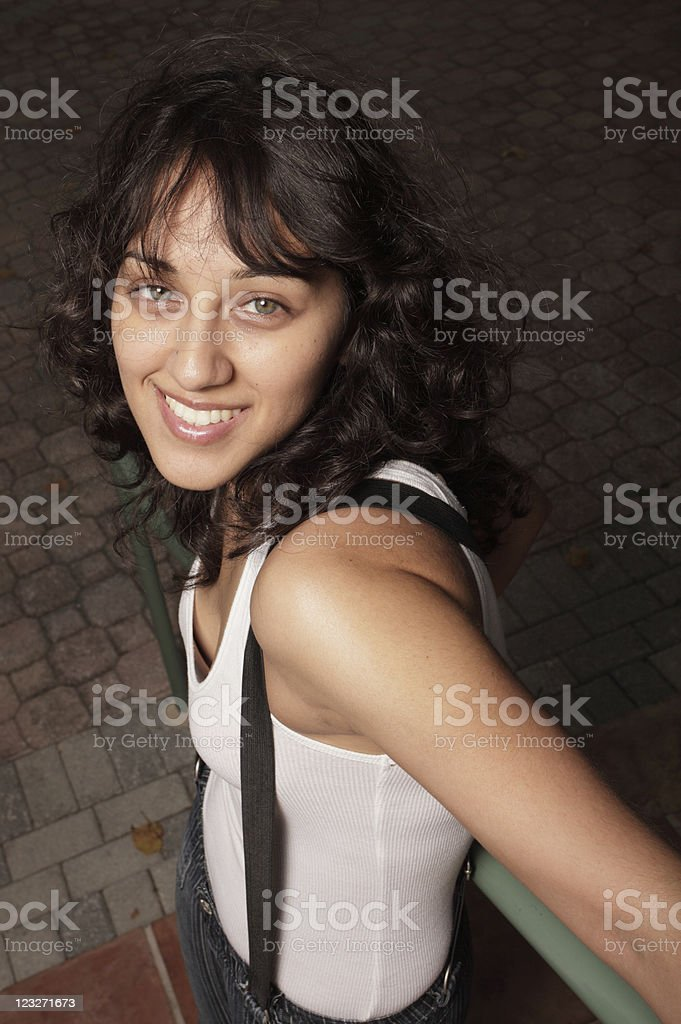 Hip young female smiling at the camera royalty-free stock photo