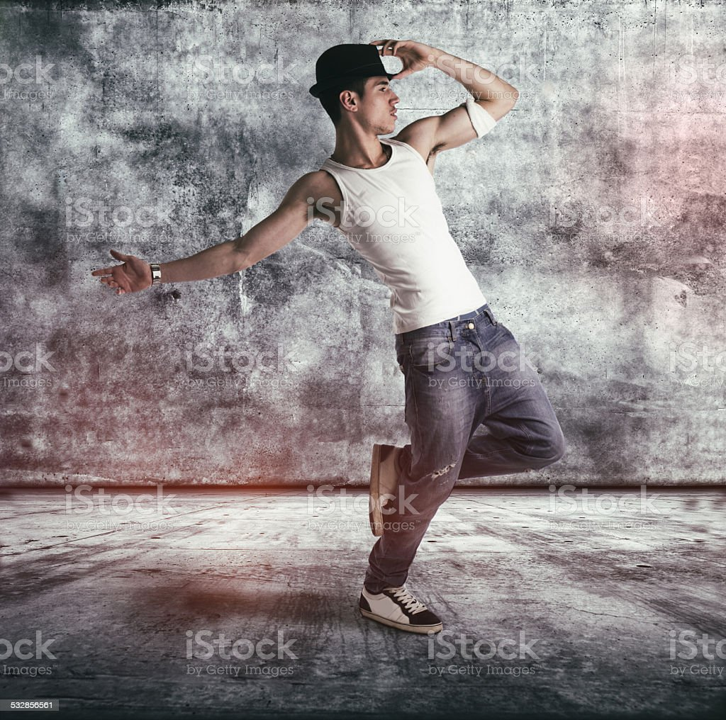 Hip young man doing a dance routine stock photo