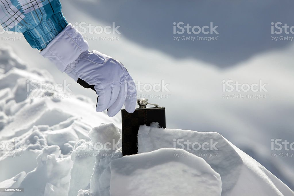 Hipflask in snow royalty-free stock photo