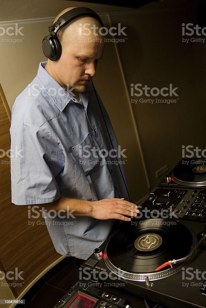 Hip-hop deejay playing vinyl record stock photo