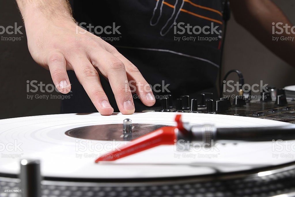 Hip-hop dj scratching record with music royalty-free stock photo
