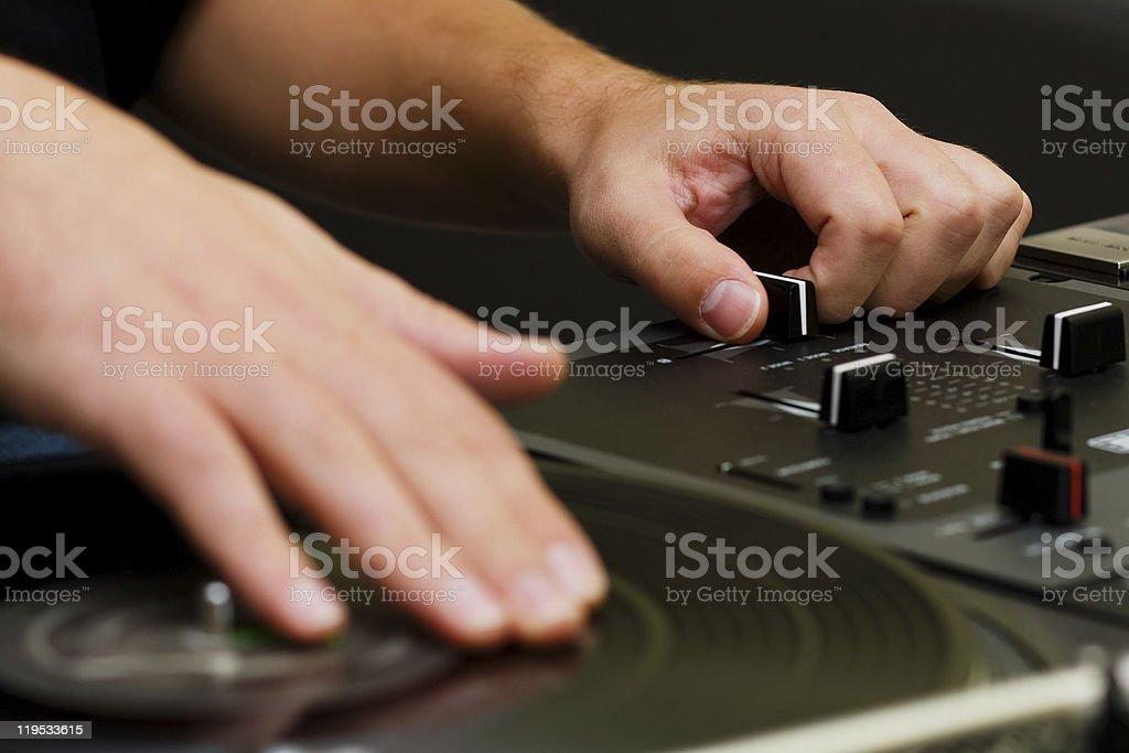 Hip-hop DJ scratching the vinyl stock photo