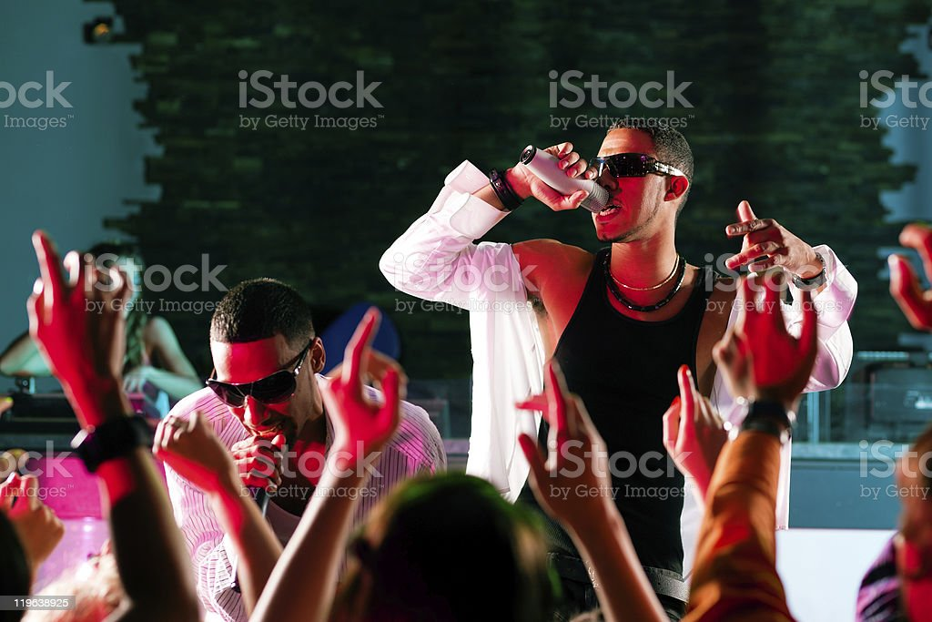 Hip-hop performers on stage in front of a crowd stock photo