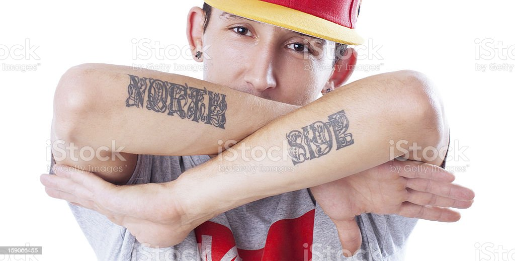 Hip-hop style, 'NORTH SIDE' tattooed man, focus on face royalty-free stock photo