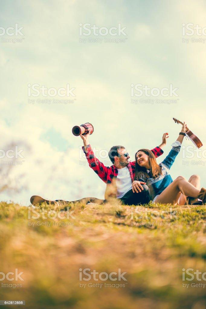 Hippie couple on mountain stock photo