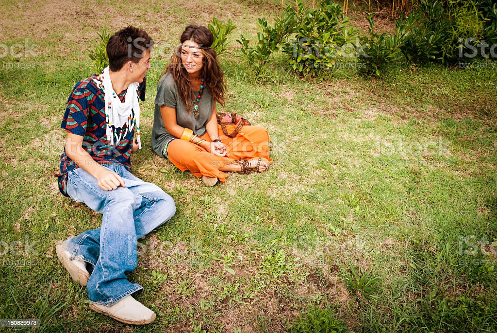 Hippie couple on the grass royalty-free stock photo