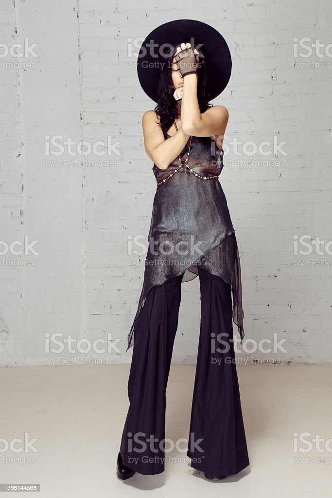 Hippie girl covered her face hands stock photo